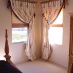 designed curtains, ornate pole